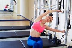 Pilates reformer woman side push through exercise Stock Photos