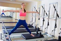 Pilates reformer woman side split exercise Stock Photography
