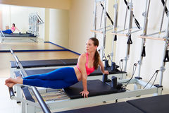 Pilates reformer woman snake twist exercise Royalty Free Stock Image