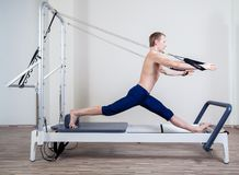 Pilates reformer workout exercises man at gym Stock Photos