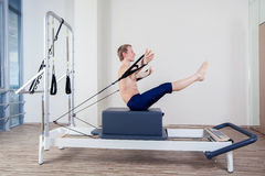 Pilates reformer workout exercises man at gym Royalty Free Stock Images
