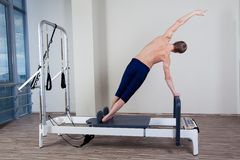 Pilates reformer workout exercises man at gym Royalty Free Stock Photography