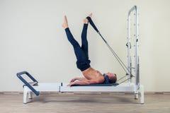 Pilates reformer workout exercises man  at gym Stock Photos