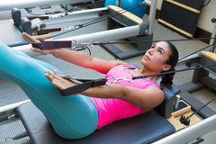 Pilates reformer workout exercises woman. Brunette at gym indoor Stock Photo