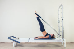 Pilates reformer workout exercises woman brunette Royalty Free Stock Photography