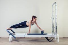 Pilates reformer workout exercises woman brunette Stock Photos