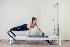 Pilates reformer workout exercises woman brunette Stock Photography