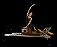 Pilates reformer workout exercises woman. At gym indoor Stock Photos
