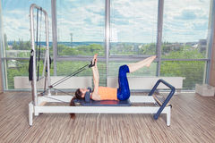 Pilates reformer workout exercises woman at gym indoor Stock Images