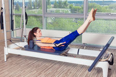 Pilates reformer workout exercises woman at gym indoor Royalty Free Stock Photo