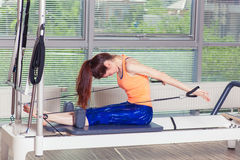 Pilates reformer workout exercises woman at gym indoor Royalty Free Stock Photography