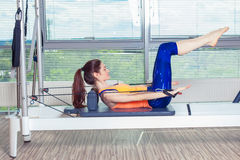Pilates reformer workout exercises woman at gym indoor Royalty Free Stock Images