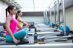 Pilates reformer workout exercises women Stock Photography