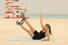 Pilates Ring Stretch on Beach Royalty Free Stock Image