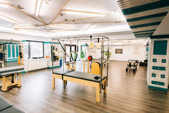 Pilates room. With several devices like trapeze table, reformers, chairs etc Stock Image