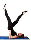 Pilates - Shoulder Stand Scissors. Young female doing Shoulder Stand Scissors Royalty Free Stock Photo