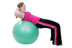 Pilates si siede in su l'esercitazione Fotografie Stock