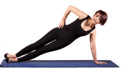 Pilates - Side Plank. Young female doing Side Plank Royalty Free Stock Photo