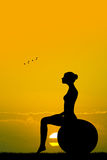 Pilates silhouette at sunset Stock Photography