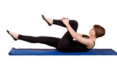 Pilates - Singlr Leg Stretch. Young female doing Single Leg Stretch Stock Photo