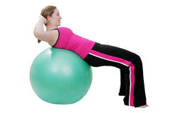 Pilates sit up exercise. Young woman exercising with green pilates ball Stock Photos