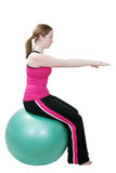Pilates stretch. Young girl stretching doing pilates exercises on a swiss ball Royalty Free Stock Images