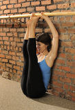 Pilates Stretch on Ballet Barre Royalty Free Stock Photo