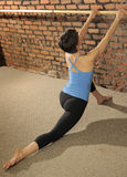 Pilates Stretch on Ballet Barre Stock Images