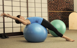 Pilates Stretch on Exercise Balls Stock Photos