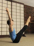 Pilates Stretch in Exercise Studio Royalty Free Stock Photography