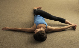 Pilates Stretch in Exercise Studio Stock Images