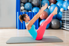 Pilates Teaser exercise woman on mat gym indoor Royalty Free Stock Photography