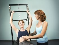 Pilates with a Trainer Royalty Free Stock Images