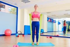 Pilates woman biceps rubber band exercise Stock Photos