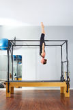 Pilates woman in cadillac acrobatic upside down Royalty Free Stock Photo
