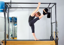 Pilates woman in cadillac split legs stretch exercise Royalty Free Stock Photography