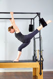 Pilates woman in cadillac split legs stretch exercise Royalty Free Stock Image