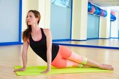 Pilates woman exercise snake workout Stock Photo