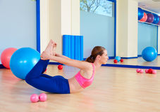 Pilates woman fitball rocking exercise workout Stock Photo
