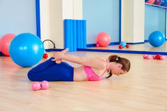 Pilates woman fitball rocking exercise workout Royalty Free Stock Image