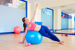 Pilates woman fitball side bend exercise workout Royalty Free Stock Image