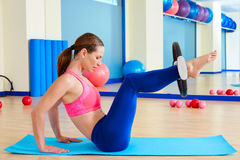 Pilates woman hip twist magic ring exercise. Workout at gym indoor Royalty Free Stock Photography