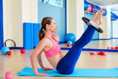 Pilates woman hip twist magic ring exercise Royalty Free Stock Image