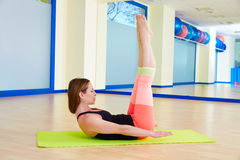 Pilates woman hundred exercise workout at gym. Indoor Stock Photography