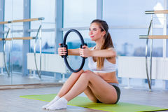 Pilates woman magic ring exercise workout at gym indoor Royalty Free Stock Photography