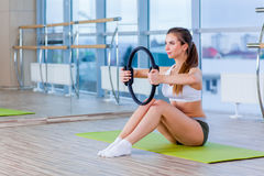 Pilates woman magic ring exercise workout at gym indoor Royalty Free Stock Image