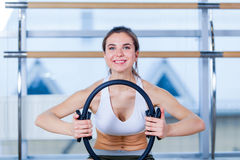 Pilates woman magic ring exercise workout at gym indoor Royalty Free Stock Photo