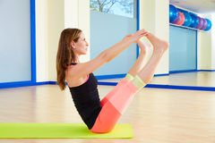 Pilates woman open leg rocker exercise workout Royalty Free Stock Photography