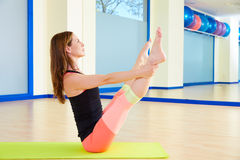 Pilates woman open leg rocker exercise workout. At gym indoor royalty free stock images