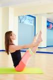 Pilates woman open leg rocker exercise workout Stock Photography